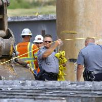 Photo - Crews are shown at the scene of a fatal industrial accident Thursday behind the Harkins Theater in Bricktown.