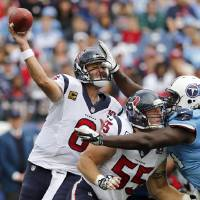Photo - Houston Texans quarterback Matt Schaub (8) gets a pass away as center Chris Myers (55) blocks Tennessee Titans defensive tackle Sen'Derrick Marks, right, in the first quarter of an NFL football game on Sunday, Dec. 2, 2012, in Nashville, Tenn. (AP Photo/Joe Howell)