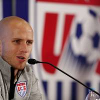 Photo - United States' Michael Bradley talks during a press conference before a training session in Sao Paulo, Brazil, Friday, June 20, 2014. The U.S. will play against Portugal in group G of the 2014 soccer World Cup on June 22. (AP Photo/Julio Cortez)