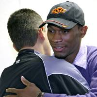 Photo - NATIONAL SIGNING DAY / SIGN: Joe Randle gets a hug from his high school football coach Gary Guzman, after Joe signed letter of intent to attend Oklahoma State University (OSU) at Southeast High School in Wichita, Kansas on Wednesday, Feb. 3, 2010. Photo by John Clanton, The Oklahoman ORG XMIT: KOD