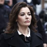 Photo - FILE - In this Wednesday, Dec. 4, 2013 file photo, British chef Nigella Lawson arrives at Isleworth Crown Court in London. The U.S. Embassy in London said on Thursday, April 3, 2014 that Lawson was denied permission to board a flight to the United States on the weekend. The embassy did not disclose the reason for refusing Lawson. (AP Photo/Sang Tan, File)