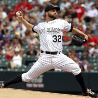 Photo - Colorado Rockies starting pitcher Tyler Chatwood works against the Cincinnati Reds in the first inning of a baseball game in Denver on Sunday, Sept. 1, 2013. (AP Photo/David Zalubowski)