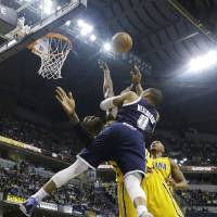 Photo - Oklahoma City Thunder's Russell Westbrook (0) shoots over Indiana Pacers' Roy Hibbert during the first half of an NBA basketball game on Friday, April 5, 2013, in Indianapolis. (AP Photo/Darron Cummings)