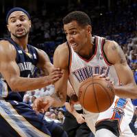 Photo - Oklahoma City's Thabo Sefolosha (2) goes past Memphis' Jerryd Bayless (7)  during Game 2 in the second round of the NBA playoffs between the Oklahoma City Thunder and the Memphis Grizzlies at Chesapeake Energy Arena in Oklahoma City, Tuesday, May 7, 2013. Photo by Bryan Terry, The Oklahoman