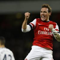 Photo - Arsenal's  Santi Carzola celebrates after scoring the opening goal during the English FA Cup third round soccer match between Arsenal and Tottenham Hotspur at the Emirates Stadium in London, Saturday, Jan. 4, 2014. (AP Photo/Kirsty Wigglesworth)