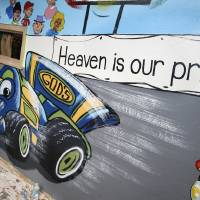 Photo - A mural featuring a race-track theme is painted by artists with Palmer Studios inside Oakcrest Church of Christ in Oklahoma City.  PAUL B. SOUTHERLAND - PAUL B. SOUTHERLAND