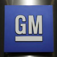 Photo -       In this  2010 file photo, a General Motors Co. logo is shown during a news conference in Detroit. General Motors is boosting by 971,000 the number of small cars being recalled worldwide for a defective ignition switch, saying cars from the model years 2008-2011 may have gotten the part as a replacement. AP Photo   Paul Sancya -  AP