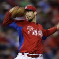 Photo - Philadelphia Phillies' Cliff Lee pitches during the third inning of an exhibition baseball game against the Toronto Blue Jays, Friday, March 29, 2013, in Philadelphia. (AP Photo/Matt Slocum)
