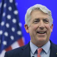 Photo - FILE - In this Dec. 18, 2013 file photo, Virginia Attorney General-elect Mark Herring smiles during a news conference at the Capitol in Richmond, Va. A federal judge ruled Thursday, Feb. 13, 2014 that Virginia's ban on same-sex marriage is unconstitutional, making it the first state in the South to have its voter-approved prohibition overturned. (AP Photo/Steve Helber, File)