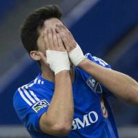 Photo - Montreal Impact's Eric Miller reacts after missing a shot on goal against the Seattle Sounders duringthe  second half of an MLS soccer game in Montreal, Sunday, March 23, 2014. (AP Photo/The Canadian Press, Graham Hughes)