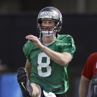 Photo - Tampa Bay Buccaneers quarterback Mike Glennon stretches during NFL football rookie minicamp Friday, May 3, 2013, in Tampa, Fla. Glennon, out of North Carolina State,  was the Buccaneers third-round pick in the 2013 draft. (AP Photo/Chris O'Meara)