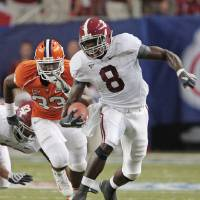 Photo - ** FILE ** In this Aug. 30, 2008 file photo, Alabama's Julio Jones (8) outruns Clemson's Kavell Conner (33) in the first quarter of their NCAA college football game at the Georgia Dome in Atlanta. Jones and Georgia's A.J. Green, rated by some as the 1-2 receivers coming out of high school and already making a big impact, will face each other on Saturday, Sept. 27.(AP Photo/Dave Martin, File) ORG XMIT: NY172