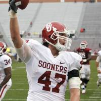 Photo - Trent Ratterree (47) celebrates a touchdown pass during the spring Red and White football game for the University of Oklahoma (OU) Sooners at Gaylord Family -- Oklahoma Memorial Stadium on Saturday, April 17, 2010, in Norman, Okla.  Photo by Steve Sisney, The Oklahoman