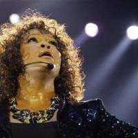 Photo - FILE - In this Sunday, April 25, 2010, file photo, U.S singer Whitney Houston performs at the o2 in London as part of her European tour, Sunday, April 25, 2010. Whitney Houston was the