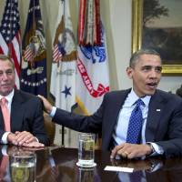 Photo - FILE - In this Nov. 16, 2012, file photo, President Barack Obama acknowledges House Speaker John Boehner of Ohio while speaking to reporters in the Roosevelt Room of the White House in Washington, as he hosted a meeting of the bipartisan, bicameral leadership of Congress to discuss the deficit and economy. The 63-year-old speaker has been caught up ever since in a monumental struggle over taxes and spending aimed at keeping the country from taking a yearend dive over the