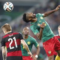 Photo - Cameroon's Alexandre Song, right, and Germany's Marco Reus challenge for the ball during a friendly WCup preparation soccer match between Germany and Cameroon in Moenchengladbach, Germany, Sunday, June 1, 2014. (AP Photo/Frank Augstein)