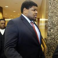 Photo - Former Dallas Cowboys NFL football player Josh Brent arrives at court for closing arguments in his intoxication manslaughter trial Tuesday, Jan. 21, 2014, in Dallas. Lawyers wrapped up their closing arguments Tuesday morning before the case went to the jury for deliberations. Prosecutors accuse the former defensive tackle of drunkenly crashing his Mercedes near Dallas during a night out in December 2012, killing his good friend and teammate, Jerry Brown. (AP Photo/LM Otero)
