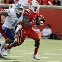 Photo -   Louisville running back Jeremy Wright (28) runs ahead of North Carolina defender Gene Robinson (1) during the first half of an NCAA college football game in Louisville, Ky., Saturday, Sept. 15, 2012. (AP Photo/Garry Jones)