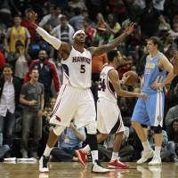 Photo - Atlanta Hawks small forward Josh Smith (5) reacts after scoring and being fouled in the final seconds of an NBA basketball game against the Denver Nuggets, Wednesday, Dec. 5, 2012, in ATlanta. Atlanta won 108-104. (AP Photo/John Bazemore)