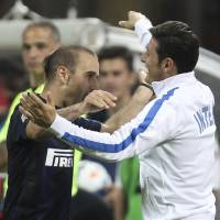 Photo - Inter Milan forward Rodrigo Palacio, left, of Argentina, celebrates with his teammate Argentine defender Javier Zanetti after scoring during the Serie A soccer match between Inter Milan and Lazio at the San Siro stadium in Milan, Italy, Saturday, May 10, 2014. (AP Photo/Antonio Calanni)