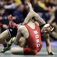 Photo - Oklahoma State's Jordan Oliver, right, controls Edinboro's David Habat during their 149-pound match at the NCAA division I college wrestling championships, Thursday, March 21, 2013, in Des Moines, Iowa. (AP Photo/Charlie Neibergall) ORG XMIT: IACN116