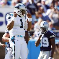 Photo -   Carolina Panthers quarterback Cam Newton (1) reacts after running the ball against the Dallas Cowboys during the first half of an NFL football game on Sunday, Oct. 21, 2012, in Charlotte, N.C. (AP Photo/Bob Leverone)
