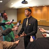 Photo - Trey Burke speaks with the media at the Devon Energy College Basketball Awards banquet at the National Cowboy & Western Heritage Museum in Oklahoma City, Monday, April 15, 2013. Photo By David McDaniel/The Oklahoman