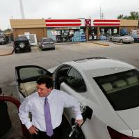 Photo - Brian Young buys gasoline Friday in Norman as Oklahoma consumers and station owners feel the crunch of high gas prices. Photo by Steve Sisney, The Oklahoman  STEVE SISNEY - THE OKLAHOMAN