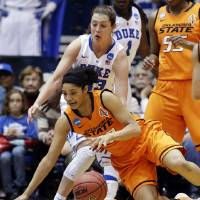 Photo - Duke's Haley Peters, rear, guards Oklahoma State's Brittney Martin during the first half of a second-round game in the women's NCAA college basketball tournament in Durham, N.C., Tuesday, March 26, 2013. (AP Photo/Gerry Broome)