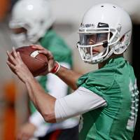 Photo - OKLAHOMA STATE UNIVERSITY / OSU / COLLEGE FOOTBALL: Oklahoma State quarterback Clint Chelf throws during an OSU spring football practice in Stillwater, Okla., Wednesday, March 13, 2013. Photo by Bryan Terry, The Oklahoman