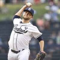 Photo - San Diego Padres starting pitcher Jesse Hahn throws against the St. Louis Cardinals in the first inning of a baseball game Wednesday, July 30, 2014, in San Diego.  (AP Photo/Lenny Ignelzi)