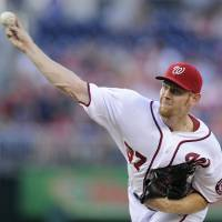 Photo - Washington Nationals starting pitcher Stephen Strasburg delivers during the third inning of a baseball game against the Colorado Rockies, Friday, June 21, 2013, in Washington. (AP Photo/Nick Wass)