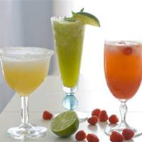 Photo - This April 2, 2012, photo made in Concord, N.H., shows three cocktails for a Cinco de Mayo celebration. (AP Photo/Matthew Mead)