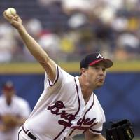 Photo - FILE - In this Sept. 22, 2002, file photo, Atlanta Braves starting pitcher Greg Maddux delivers to a Florida Marlins batter in the first inning of a baseballl game at Turner Field in Atlanta. Mad Dog and Glav were fixtures in the Atlanta Braves rotation for years, and now they await word on another possible honor that will keep them together: induction into the Baseball Hall of Fame. (AP Photo/Erik S. Lesser, File)