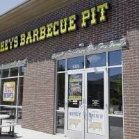 Photo - Dickey's Barbecue Pit is shown Monday, Aug. 18, 2014, in South Jordan, Utah. The Utah police agency investigating how iced tea that a woman drank at a restaurant ended up laced with an industrial cleaning solution is forwarding its findings to prosecutors to determine if anybody should be charged. Authorities have said an employee at Dickey's Barbecue in South Jordan unintentionally put the heavy-duty cleaner in a sugar bag, and a worker later mistakenly mixed it into the iced tea dispenser. (AP Photo/Rick Bowmer)