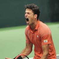 Photo - Robin Haase from the Netherlands celebrates after he defeated Radek Stepanek from the Czech Republic in their opening single of the tennis Davis Cup first round match in Ostrava, Friday, Jan. 31, 2014. Haase won 3-6, 6-4, 6-7, 6-2 ,1-6.  (AP Photo,CTK/Jaroslav Ozana) SLOVAKIA OUT