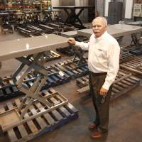 Photo - Autoquip President Joe Robillard shows some of the hydraulic lifts at the production plant in Guthrie, OK, Tuesday, February 5, 2013,  By Paul Hellstern, The Oklahoman