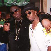 Photo - **FILE**In this March 8, 1997 file photo, Notorious B.I.G., whose real name is Christopher Wallace, left, gestures as he and producer Sean