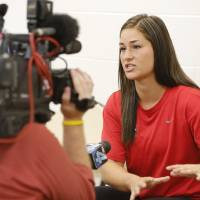Photo - WOMEN'S SOFTBALL / OU: University of Oklahoma's Lauren Chamberlain is interviewed by reporters during a press conference at ASA Hall of Fame Stadium Complex in Oklahoma City, Tuesday July 9, 2013. Photo By Steve Gooch, The Oklahoman