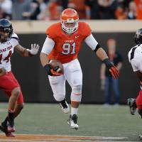 Photo - Oklahoma State's James Castleman (91) runs with the ball after making an interception during the college football game between the Oklahoma State University Cowboys (OSU) and Texas Tech University Red Raiders (TTU) at Boone Pickens Stadium on Saturday, Nov. 17, 2012, in Stillwater, Okla.   Photo by Chris Landsberger, The Oklahoman