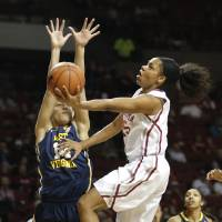 Photo - Oklahoma Gioya Carter (25) shoots as West Virginia forward Jess Harlee (14) defends  during the women's basketball game between, University of Oklahoma and West Virginia, Thursday, Feb. 13, 2014, in Norman, Okla. Photo by Sarah Phipps, The Oklahoman