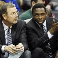Photo - FILE- In this Dec. 17, 2011, file photo, New Jersey Nets head coach Avery Johnson, right, talks with assistant coach P.J. Carlesimo during the first half of an NBA preseason basketball game against the New York Knicks in Newark, N.J. The Nets fired Johnson on Thursday, Dec. 27, 2012, and Carlesimo will coach the team on an interim basis, starting Friday night with a home game against Charlotte. (AP Photo/Mel Evans, File)