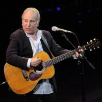 Photo - FILE - This April 2, 2012 file photo shows singer Paul Simon performing at