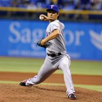 Photo - Texas Rangers starting pitcher Yu Darvish, of Japan, delivers to the Tampa Bay Rays during the fifth inning of a baseball game Thursday, Sept. 19, 2013, in St. Petersburg, Fla. (AP Photo/Brian Blanco)