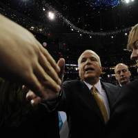 Photo - Republican presidential candidate John McCain shakes hands in the crowd after his acceptance speech during the Republican National Convention in St. Paul, Minn., Thursday, Sept. 4, 2008. (AP Photo/Susan Walsh) ORG XMIT: MNTG144