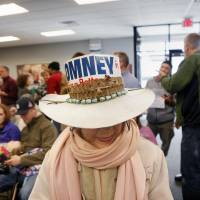 Photo -   Joyce Verplank Hatton of Spring Lake wears a hat supporting presidential candidate Mitt Romney while attending a rally with his sons, Matt and Josh Romney, on Monday, Nov. 5 at the Kent County Republican Party Headquarters. Verplank Hatton worked for George Romney's national campaign in 1968. (AP Photo/Grand Grapids Press, Emily Zoldaz) ALL LOCAL TV OUT; LOCAL TV INTERNET OUT