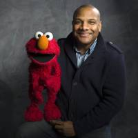 Photo -   FILE - In this Jan. 24, 2011 file photo, Elmo puppeteer Kevin Clash poses with the