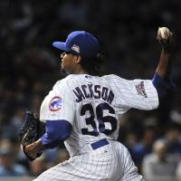 Photo - Chicago Cubs starting pitcher Edwin Jackson delivers in the first inning of a baseball game against the San Francisco Giants on Wednesday, August 20, 2014, in Chicago. (AP Photo/Matt Marton)