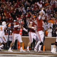 Photo - Oklahoma's Blake Bell (10) celebrates after scoring a touchdown at the end of regulation during the Bedlam college football game between the University of Oklahoma Sooners (OU) and the Oklahoma State University Cowboys (OSU) at Gaylord Family-Oklahoma Memorial Stadium in Norman, Okla., Saturday, Nov. 24, 2012. Oklahoma won 51-48. Photo by Bryan Terry, The Oklahoman