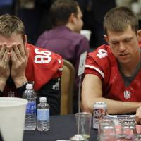 Photo - San Francisco 49ers long snapper Brian Jennings (86) and punter Andy Lee (4) wait to be interviewed during a media availability on Wednesday, Jan. 30, 2013, in New Orleans. The 49ers are scheduled to play the Baltimore Ravens in the NFL Super Bowl XLVII football game on Feb. 3. (AP Photo/Mark Humphrey)